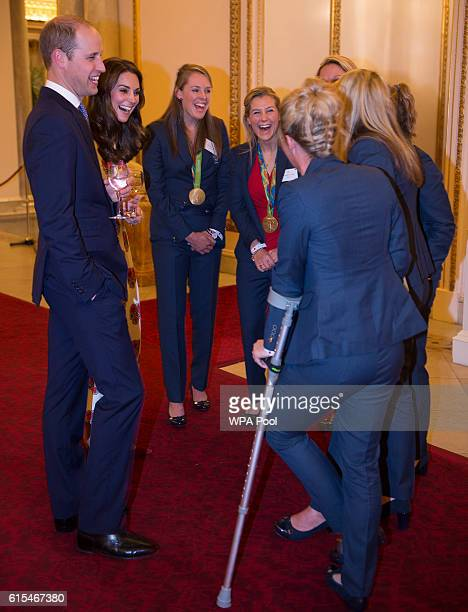 Prince William Duke of Cambridge and Catherine Duchess of Cambridge speak with Ladies Hockey Team with Susannah Townsend on crutches at a reception...