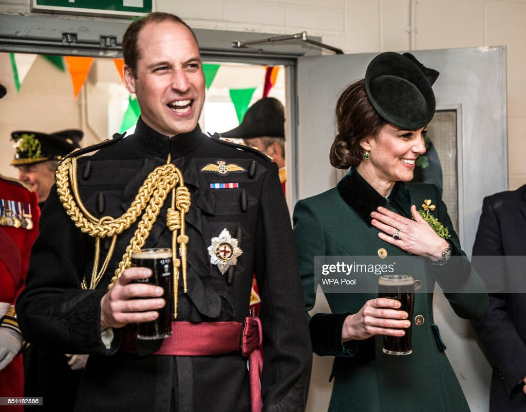 Prince William, Duke Of Cambridge and Catherine, Duchess of Cambridge take a drink of Guinness as they meet with soldiers of the 1st battalion Irish Guards in their canteen following their St Patricks day parade at Cavalry Barracks on March 17, 2017 in London, England.
