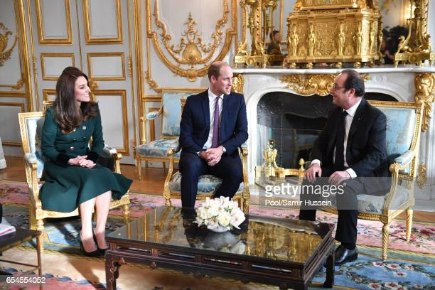 Prince William Duke of Cambridge and Catherine Duchess of Cambridge meet President Francois Hollande at The Elysee Palace on March 17 2017 in Paris...