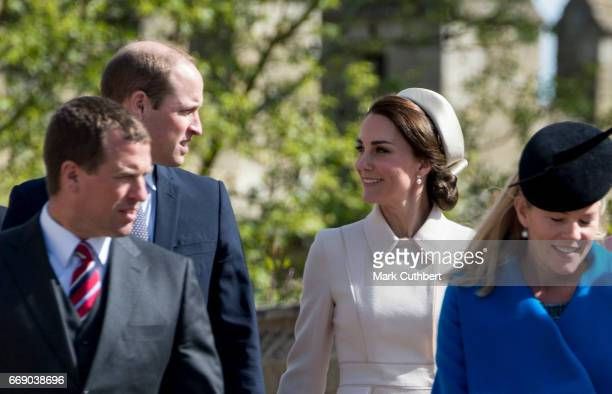Prince William Duke of Cambridge and Catherine Duchess of Cambridge with Peter Phillips and Autumn Phillips attend the Easter Day service at St...