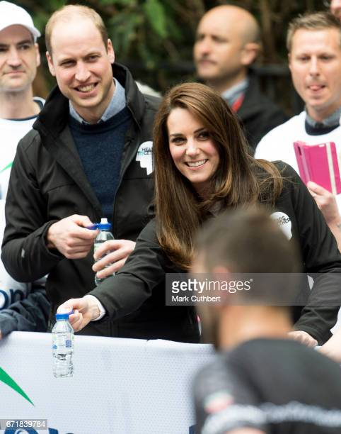 Prince William, Duke of Cambridge and Catherine, Duchess of Cambridge helping at a water station during the 2017 Virgin Money London Marathon on...