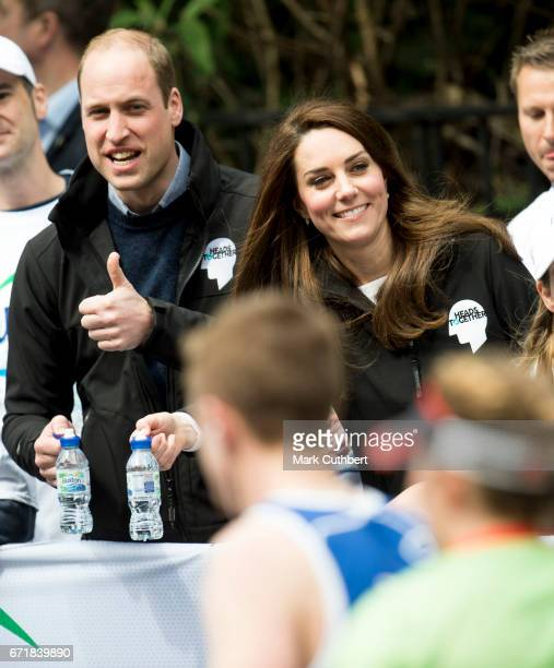 Prince William Duke of Cambridge and Catherine Duchess of Cambridge helping at a water station during the 2017 Virgin Money London Marathon on April...