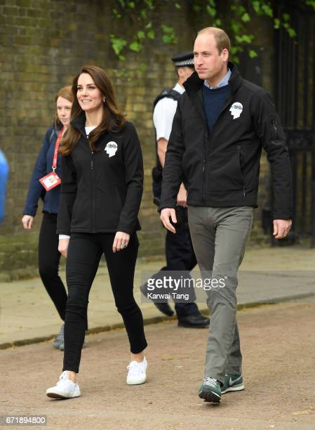 Prince William, Duke of Cambridge and Catherine, Duchess of Cambridge meet volunteers during the 2017 Virgin Money London Marathon on April 23, 2017...