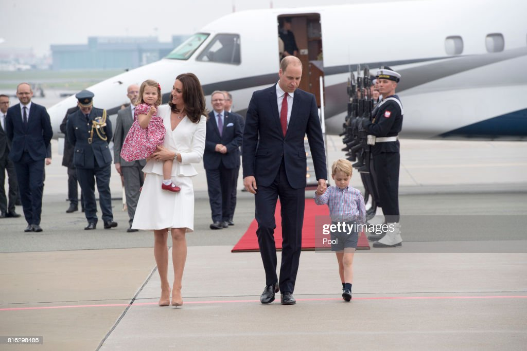 Prince William, Duke of Cambridge and Catherine, Duchess of Cambridge with their children Prince George and Princess Charlotte arrive at Warsaw airport to start a 3 day tour on July 17, 2017 in Warsaw, Poland.