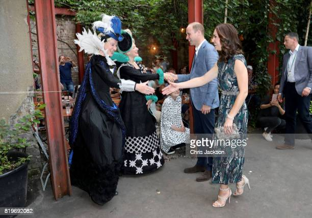 Prince William Duke of Cambridge and Catherine Duchess of Cambridge shake hands as they arrive at the last original dancehall in Berlin the Clärchens...