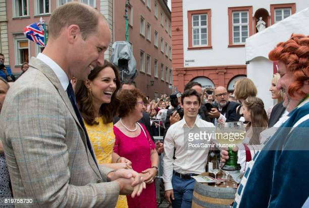 Prince William Duke of Cambridge and Catherine Duchess of Cambridge tour of a traditional German market in the Central Square during an official...