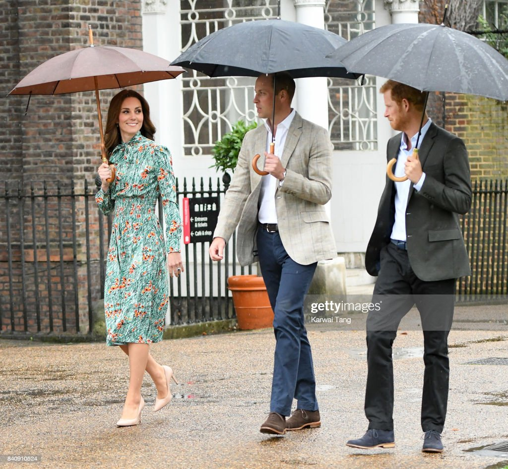 Prince William, Duke of Cambridge and Catherine, Duchess of Cambridge with Prince Harry during a visit to The Sunken Garden at Kensington Palace on August 30, 2017 in London, England. The garden has been transformed into a White Garden dedicated in the memory of Princess Diana, mother of Prince WIlliam, Duke of Cambridge and Prince Harry.