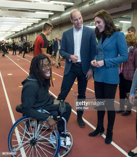 Prince William Duke of Cambridge and Catherine Duchess of Cambridge chat with Ade Adepitan during the Coach Core graduation ceremony for more than...