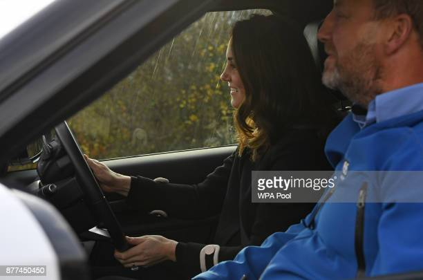 Prince William Duke of Cambridge and Catherine Duchess of Cambridge drives a Land Rover Discovery as they takes part in an offroad driving experience...