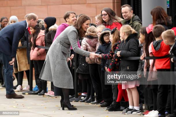 Prince William Duke of Cambridge and Catherine Duchess of Cambridge talk to children as they attend a 'Stepping Out' session at Media City on...