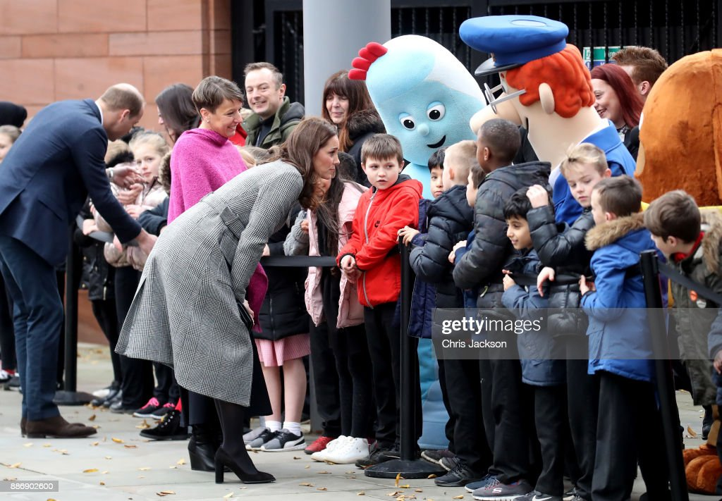 Prince William, Duke of Cambridge and Catherine, Duchess of Cambridge talk to children as they attend a 'Stepping Out' session at Media City on December 6, 2017 in Manchester, England. The session is a focus group where young people are able to give children's television editorial staff and content producers their view of how they respond to new programmes under production.
