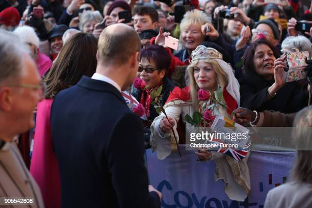 Prince William Duke of Cambridge and Catherine Duchess of Cambridge speak to a woman in the crowd dressed as Lady Godiva as they arrive for their...