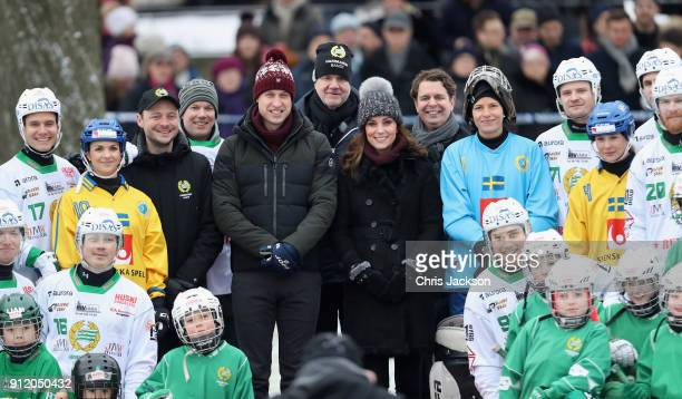 Prince William Duke of Cambridge and Catherine Duchess of Cambridge pose with players as they attend a Bandy hockey match where they will learn more...