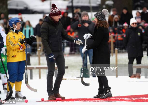 Prince William Duke of Cambridge and Catherine Duchess of Cambridge laugh as they attend a Bandy hockey match where they will learn more about the...