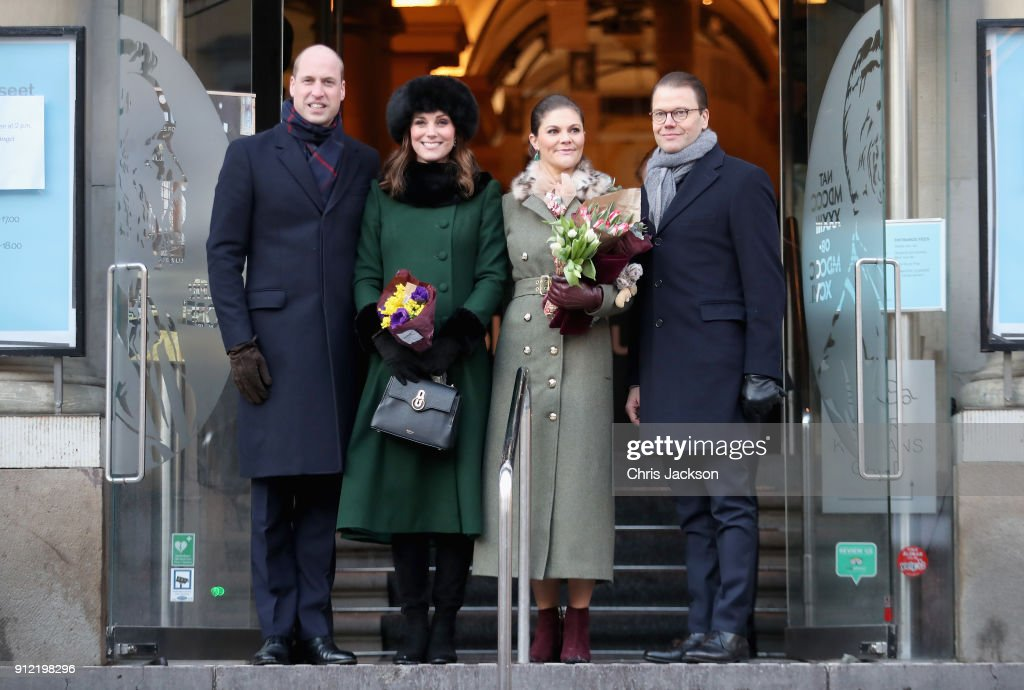 Prince William, Duke of Cambridge and Catherine, Duchess of Cambridge with Crown Princess Victoria of Sweden and Prince Daniel of Sweden pose as they walk through the cobbled streets of Stockholm from the Royal Palace to the Nobel Museum during day one of their Royal visit to Sweden and Norway on January 30, 2018 in Stockholm, Sweden.