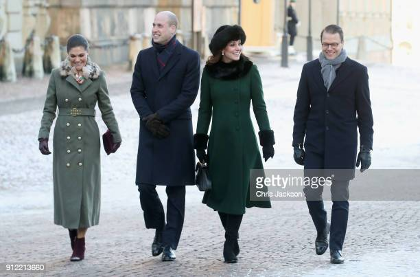 Prince William Duke of Cambridge and Catherine Duchess of Cambridge with Crown Princess Victoria and Prince Daniel of Sweden walk through the cobbled...