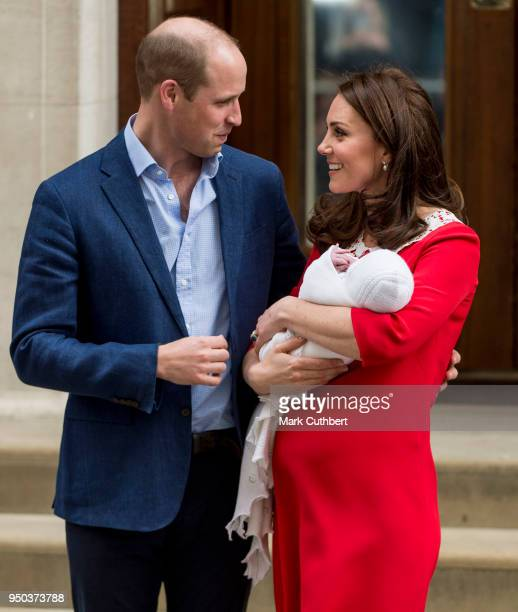 Prince William Duke of Cambridge and Catherine Duchess of Cambridge leave with their new born baby boy from the Lindo Wing St Mary's Hospital on...