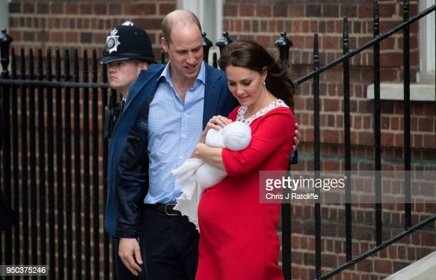 Prince William Duke of Cambridge and Catherine Duchess of Cambridge leave the Lindo Wing of St Mary's Hospital with their new born baby boy on April...