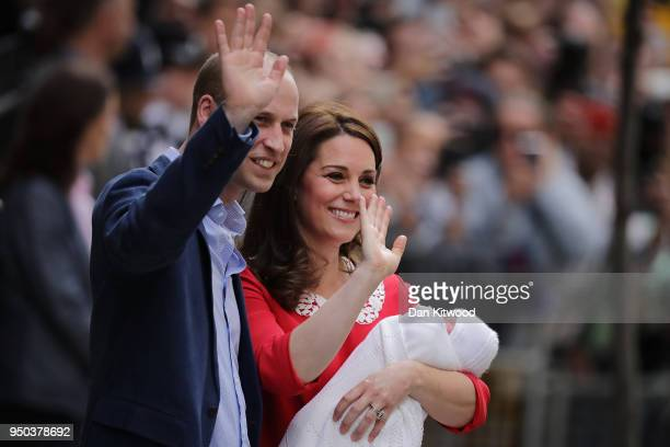 Prince William Duke of Cambridge and Catherine Duchess of Cambridge pose for photographers with their newborn baby boy outside the Lindo Wing of St...