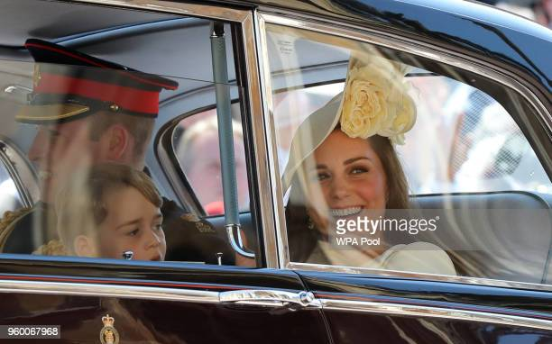 Prince William Duke of Cambridge and Catherine Duchess of Cambridge and Prince George leave St George's Chapel at Windsor Castle after the wedding of...