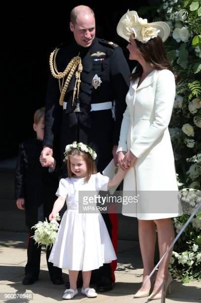 Prince William Duke of Cambridge and Catherine Duchess of Cambridge with Prince George and Princess Charlotte leave St George's Chapel Windsor Castle...