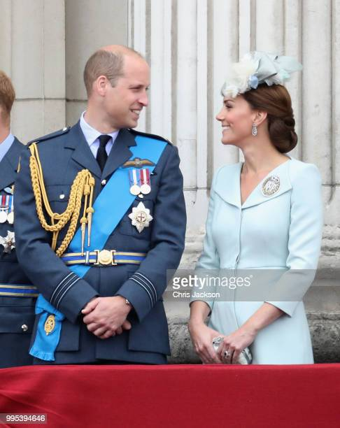 Prince William Duke of Cambridge and Catherine Duchess of Cambridge watch the RAF flypast on the balcony of Buckingham Palace as members of the Royal...