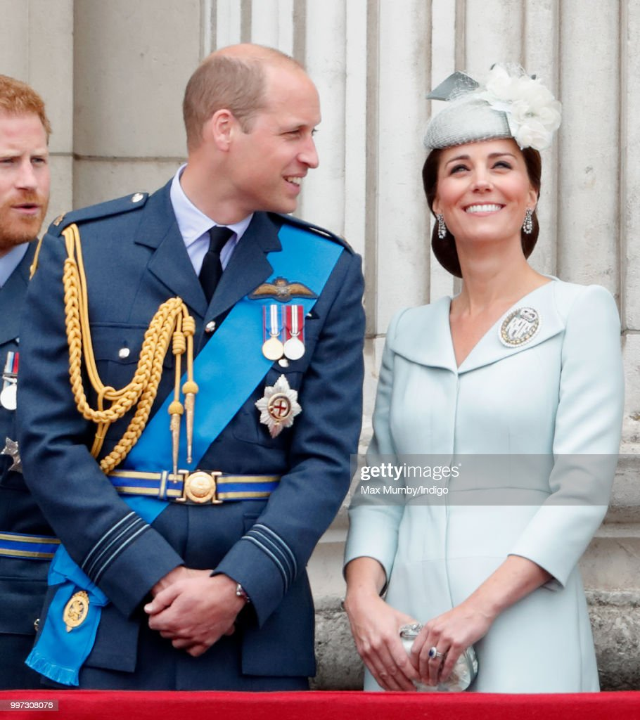 Prince William, Duke of Cambridge and Catherine, Duchess of Cambridge watch a flypast to mark the centenary of the Royal Air Force from the balcony of Buckingham Palace on July 10, 2018 in London, England. The 100th birthday of the RAF, which was founded on on 1 April 1918, was marked with a centenary parade with the presentation of a new Queen's Colour and flypast of 100 aircraft over Buckingham Palace.