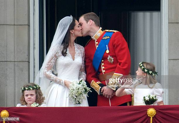 Prince William, Duke of Cambridge and Catherine Middleton, Duchess of Cambridge kiss on the balcony of Buckingham Palace following their wedding on...