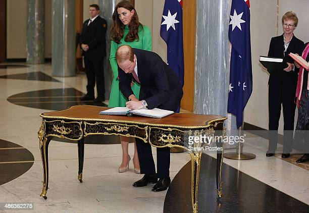 Prince William, Duke of Cambridge and Catherine, the Duchess of Cambridge sign the Prime Minister's and Presiding Officer's Visitors books on the...