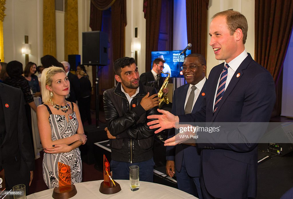 Prince William, Duke of Cambridge (R) and Centrepoint Chief Executive Seyi Obakin (2nd Rt) talk to award winners Rebecca Stephenson (L) and Ezat Gulzaman at the HSBC private bank on November 19, 2015 in London, England. The event is the first awards ceremony for the youth homeless charity, celebrating the achievements of young people who have changed the direction of their lives after experiencing homelessness.