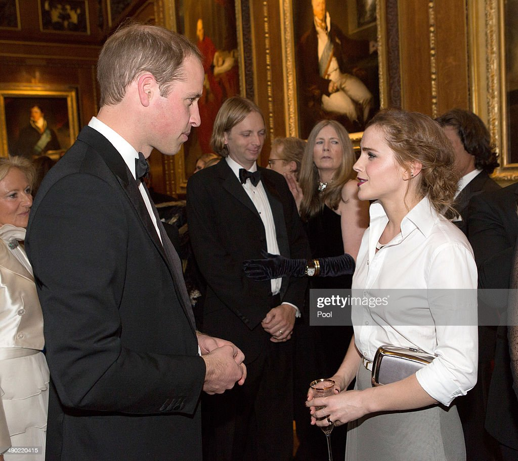 Prince William, Duke of Cambridge (L) and Emma Watson attend a dinner to celebrate the work of The Royal Marsden hosted by the Duke of Cambridge on May 13, 2014 in Windsor, England.