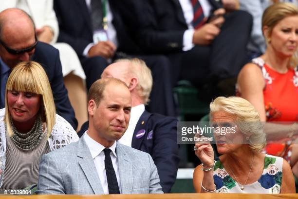 Prince William Duke of Cambridge and Gill Brook look on from the centre court royal box prior to the Gentlemen's Singles final between Roger Federer...