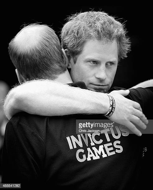 Prince William Duke of Cambridge and his brother Prince Harry hug as the Duke leaves during the Invictus Games athletics at Lee Valley on September...