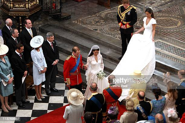 Prince William Duke of Cambridge and his new bride Catherine Duchess of Cambridge bow to Queen Elizabeth II at the close of their wedding ceremony at...