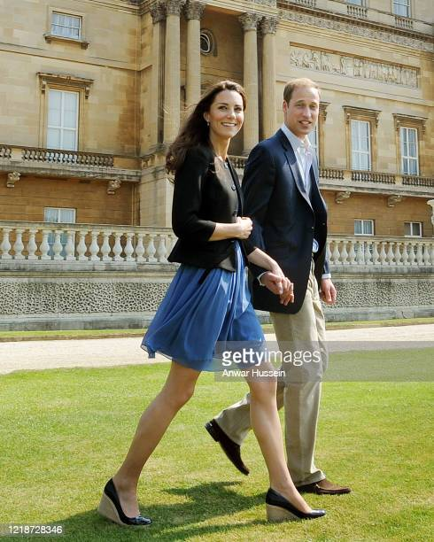 Prince William, Duke of Cambridge and his new bride Catherine, Duchess of Cambridge walk hand in hand from Buckingham Palace on the day after their...