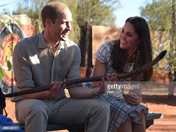 Prince William Duke of Cambridge and his wife Catherine Duchess of Cambridge inspect a wooden snake made by Aboriginal elders during a visit to...