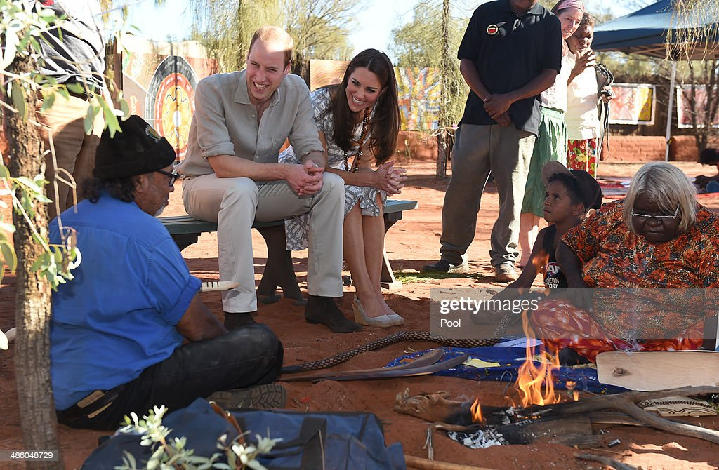 Prince William, Duke of Cambridge (L) and his wife Catherine, Duchess of Cambridge (R) inspect a wooden snake made by Aboriginal elders during a visit to Uluru-Kata Tjuta Cultural Centre at Uluru on April 22, 2014 in Ayers Rock, Australia. The Duke and Duchess of Cambridge are on a three-week tour of Australia and New Zealand, the first official trip overseas with their son, Prince George of Cambridge.