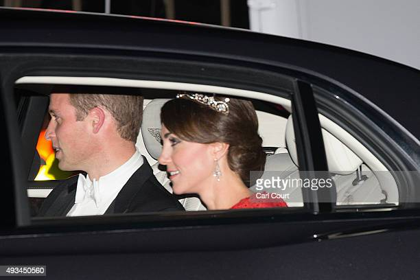 Prince William Duke of Cambridge and his wife Catherine Duchess of Cambridge wearing a tiara made by Garrard London arrive for a state banquet to...