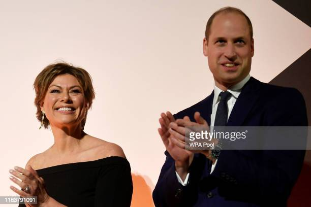 Prince William Duke of Cambridge and host Kate Silverton appear on stage during the Tusk Conservation Awards at The Empire Cinema on November 21 2019...