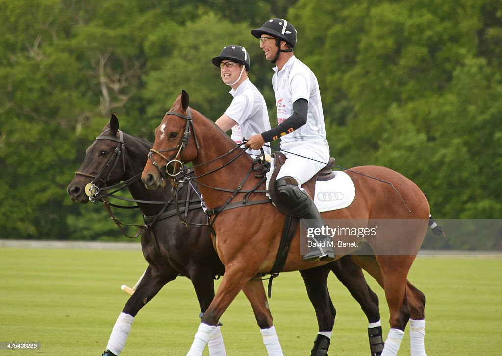 Prince William, Duke of Cambridge, and John Paul Clarkin play during day two of the Audi Polo Challenge at Coworth Park on May 31, 2015 in London, England.