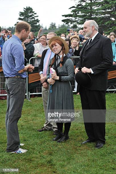 Prince William Duke of Cambridge and meet an actress dressed as the characater Anne of Green Gables as they arrive on shore after rowing dragon boats...