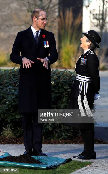 Prince William Duke of Cambridge and Metropolitan Police Commissioner Cressida Dick prepare to plant a tree in the memorial garden at the...