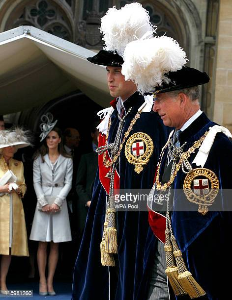 Prince William Duke of Cambridge and Prince Charles Prince of Wales are watched by their wives Catherine Duchess of Cambridge and Camilla Duchess of...