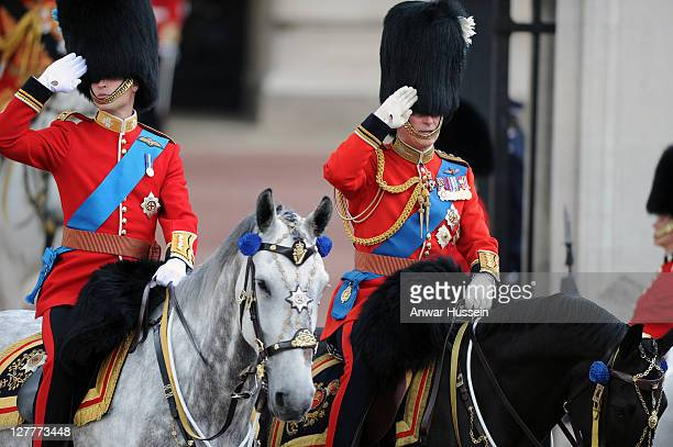 Prince William Duke of Cambridge and Prince Charles Prince of Wales salute as they attend the Trooping The Colour Ceremony on June 11 2011 in London...