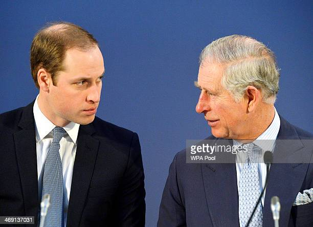 Prince William Duke of Cambridge and Prince Charles Prince of Wales listen to speeches by foreign leaders at the Illegal Wildlife Trade Conference at...