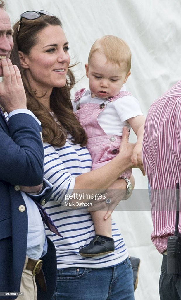 Prince William, Duke of Cambridge and Prince George attend the Jerudong Park Trophy at Cirencester Park Polo Club on June 15, 2014 in Cirencester, England.