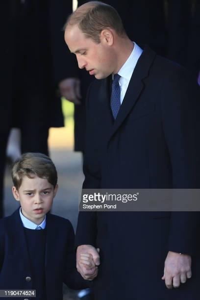 Prince William Duke of Cambridge and Prince George leave as Prince George watches after attending the Christmas Day Church service at Church of St...