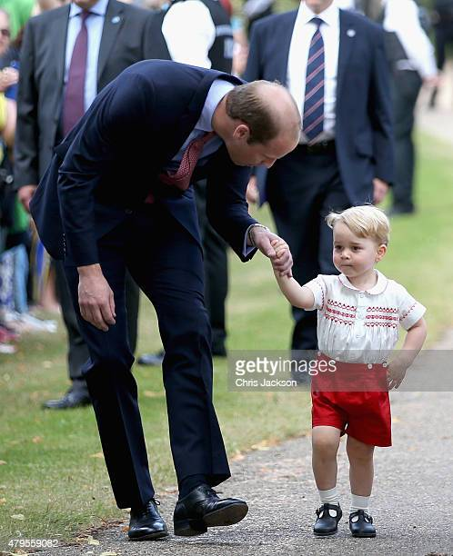 Prince William Duke of Cambridge and Prince George of Cambridge are saluted by a policeman as they arrive at the Church of St Mary Magdalene on the...