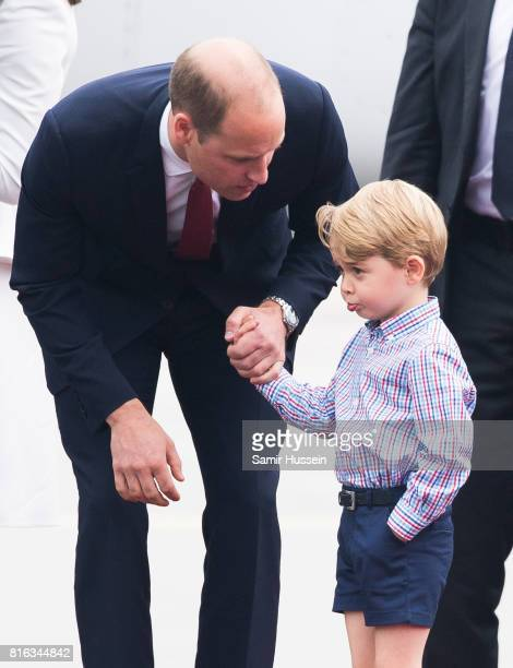 Prince William Duke of Cambridge and Prince George of Cambridge arrive at Warsaw airport during an official visit to Poland and Germany on July 17...