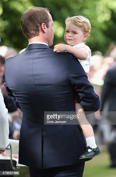 Prince William, Duke of Cambridge and Prince George of Cambridge leave the Church of St Mary Magdalene on the Sandringham Estate for the Christening...
